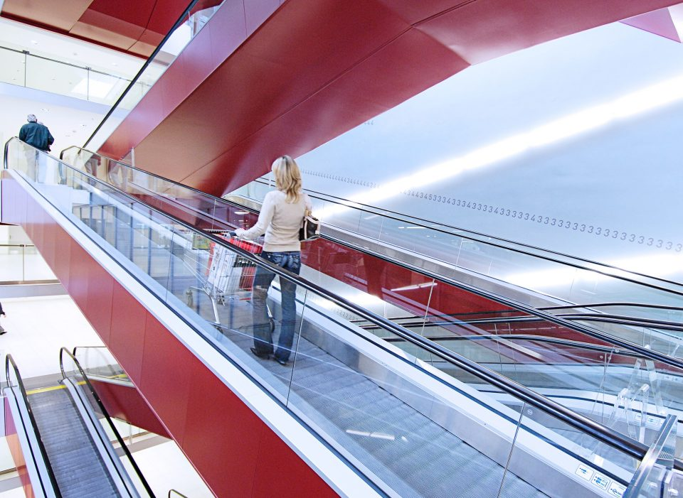 Lady on escalator