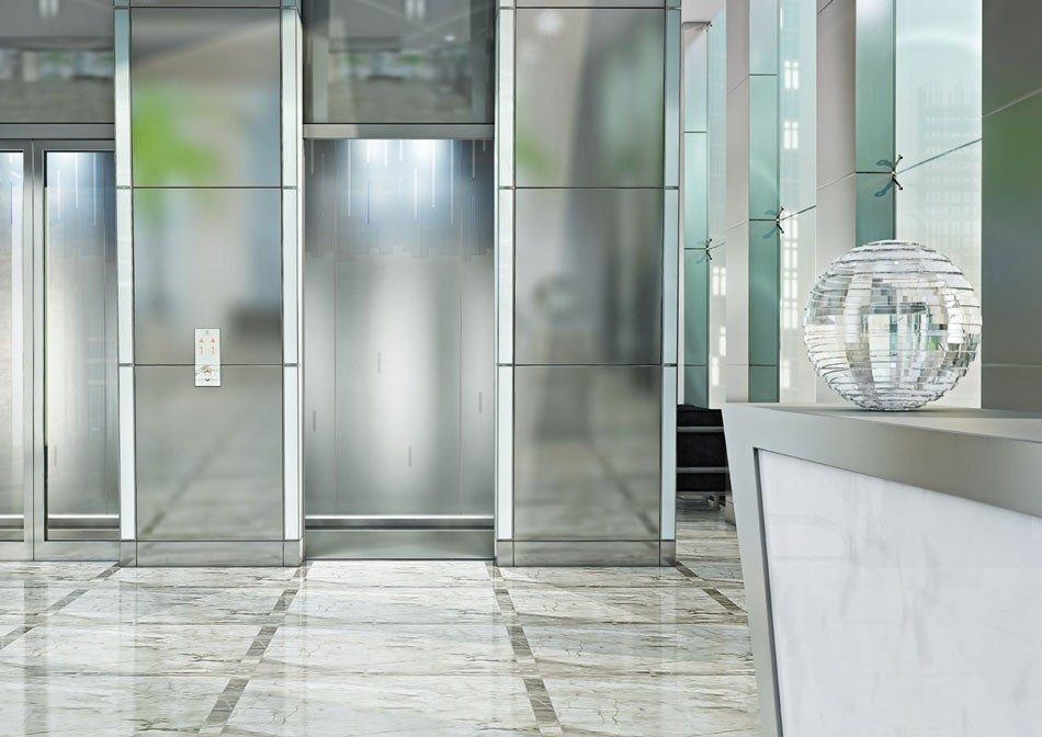 Glass cab - The Schindler 5500 MRL offers sleek glass walls and doors that can be customized to fit any building's style.