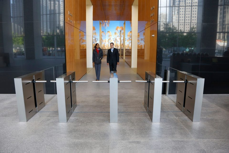 Lobby turnstiles at 4 World Trade Center - The turnstiles in the 4 World Trade Center lobby are fully integrated with the building's security and elevator systems to provide the latest in building access control.