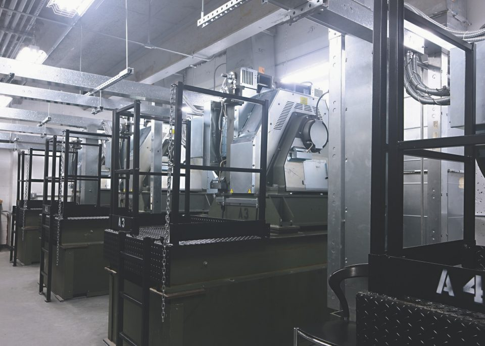 Motors in elevator machine room at 4 World Trade Center - Eco-friendly permanent magnet motors feature Power Factor 1 regenerative drives with industry-leading .99 efficiency, capable of returning power back into the building's power grid.