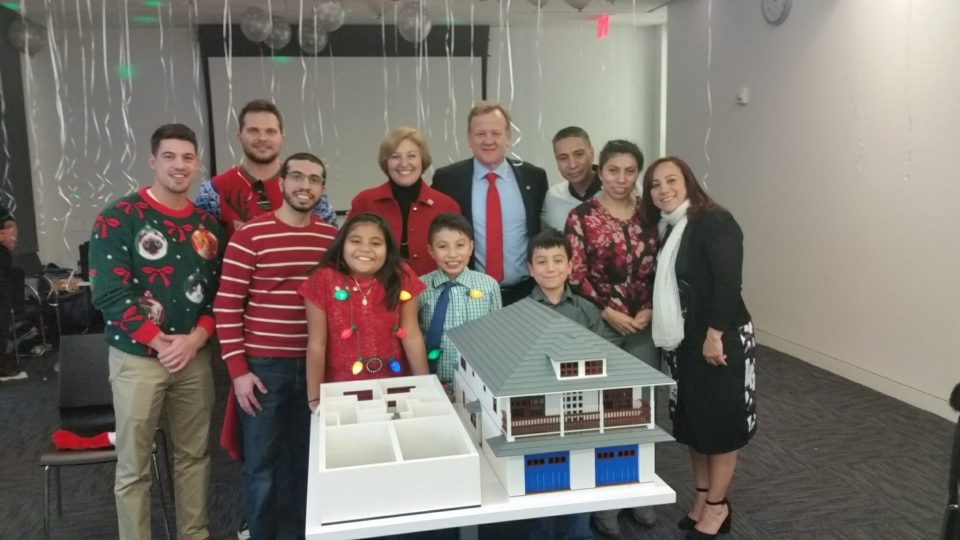 Schindler Holiday Party - Morris Habitat families attend Schindler's annual holiday party for the reveal of the Lego house replica of 10 Willow Street